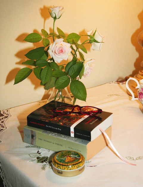 Books and roses on table top